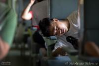 man-head-sleeping-train-thailand